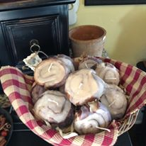 Candle 9 Cinnamon Buns in basket with Checkered Napkin